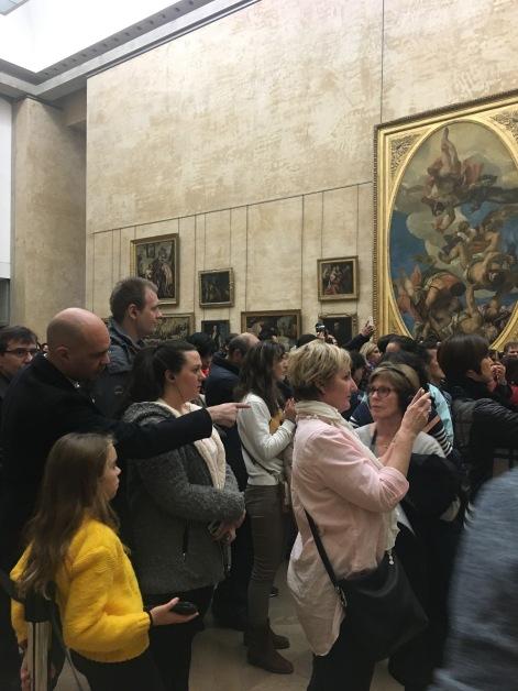Menschen fotografieren, die die Mona Lisa fotografieren...